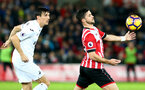 Shane Long under pressure from Jack Cork during the Premier League match between Swansea City and Southampton at the Liberty Stadium, Swansea, Wales on 31 January 2017. Photo by Matt Watson/SFC/Digital South.