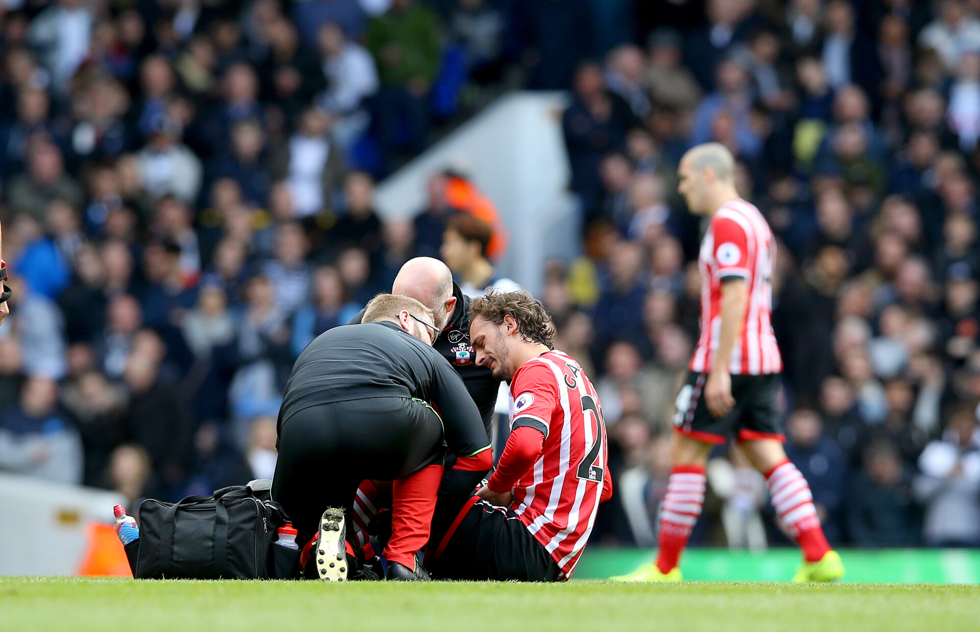 Manolo Gabbiadini goes of injured during the Premier League match between Tottenham Hotspur and Southampton at White Hart Lane, London, England on 19 March 2017. Photo by Matt  Watson/SFC/Digital South.