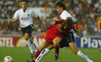 VALENCIA - SEPTEMBER 17:   Michael Owen of Liverpool is tackles by Mauricio Pellegrino of Valencia CF during the UEFA Champions League First Stage, Group B match between Valencia CF and Liverpool at the Estadio de Mestalla in Valencia, Spain on September 17, 2002. (Photo by Phil Cole/Getty Images)