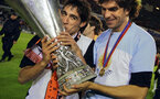 GOTHENBURG, Sweden:  Valencia's Spanish midfielder Rogriguez Vicente (L) and Argentinian defender Mauricio Pellegrino hold the trophy after beating Marseille 2-0 in the final of the UEFA cup football match at the Ullevi Stadium in Gothenburg, 19 May 2004. AFP PHOTO JAVIER SORIANO  (Photo credit should read JAVIER SORIANO/AFP/Getty Images)