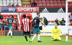 Charlie Austin scores his second during the pre-season friendly between Brentford FC(red/white) and Southampton FC(black), at Griffin Park Stadium, Brentford, London, 22nd July 2017
