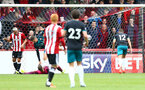 Brentford equalise during the pre-season friendly between Brentford FC(red/white) and Southampton FC(black), at Griffin Park Stadium, Brentford, London, 22nd July 2017