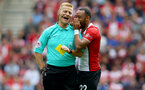 SOUTHAMPTON, ENGLAND - AUGUST 12: Southampton's Nathan Redmond speaks to referee Mike Jones during the Premier League match between Southampton and Swansea City at St Mary's Stadium on August 12, 2017 in Southampton, England. (Photo by Matt Watson/Southampton FC via Getty Images)