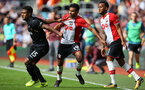 SOUTHAMPTON, ENGLAND - AUGUST 12: Southampton's Sofiane Boufal(centre) has his shirt pulled by Wayne Routledge during the Premier League match between Southampton and Swansea City at St Mary's Stadium on August 12, 2017 in Southampton, England. (Photo by Matt Watson/Southampton FC via Getty Images)
