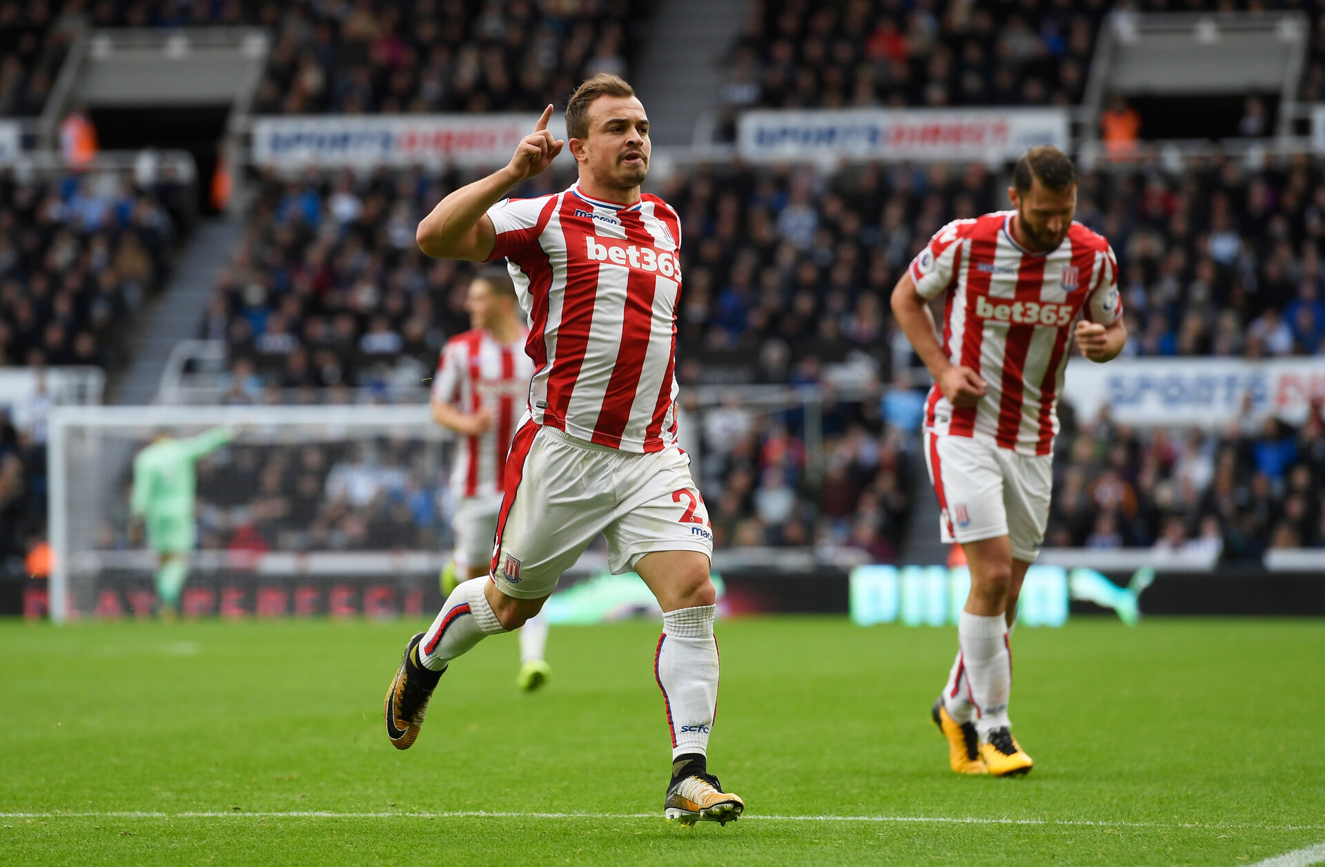 NEWCASTLE UPON TYNE, ENGLAND - SEPTEMBER 16: Xherdan Shaqiri of Stoke City celebrates scoring his sides first goal during the Premier League match between Newcastle United and Stoke City at St. James Park on September 16, 2017 in Newcastle upon Tyne, England.  (Photo by Stu Forster/Getty Images)