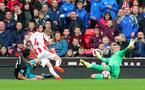 STOKE ON TRENT, ENGLAND - SEPTEMBER 30: Southampton keeper Fraser Forster saves from Joe Allen during the Premier League match between Stoke City and Southampton at the Bet365 Stadium on September 30, 2017 in Stoke on Trent, England. (Photo by Matt Watson/Southampton FC via Getty Images)