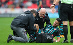 STOKE ON TRENT, ENGLAND - SEPTEMBER 30: Southampton's Shane Long receives treatment during the Premier League match between Stoke City and Southampton at the Bet365 Stadium on September 30, 2017 in Stoke on Trent, England. (Photo by Matt Watson/Southampton FC via Getty Images)