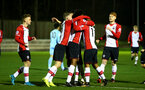SOUTHAMPTON, ENGLAND - DECEMBER 11: Southampton FC players celebrate after scoring during the Premier League 2 between Southampton FC and Wolverhampton FC U23's match at Staplewood Complex on December 11, 2017 in Southampton, England. (Photo by James Bridle - Southampton FC/Southampton FC via Getty Images)