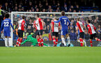 LONDON, ENGLAND - DECEMBER 16: Marcos Alonso scores for Chelsea during the Premier League match between Chelsea and Southampton at Stamford Bridge on December 16, 2017 in London, England. (Photo by Matt Watson/Southampton FC via Getty Images)