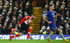LONDON, ENGLAND - DECEMBER 16: LtoR Charlie Austin of Southampton shoots against Gary Cahil of Chelsea FC durng the Premier League match between Chelsea and Southampton FC at Stamford Bridge on December 16, 2017 in London, England. (Photo by James Bridle - Southampton FC/Southampton FC via Getty Images)