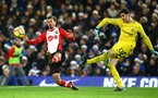 LONDON, ENGLAND - DECEMBER 16: LtoR Manolo Gabbiadini of Southampton charges Thibaut Courtois of Chelsea FC during the Premier League match between Chelsea and Southampton FC at Stamford Bridge on December 16, 2017 in London, England. (Photo by James Bridle - Southampton FC/Southampton FC via Getty Images)