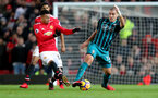 MANCHESTER, ENGLAND - DECEMBER 30: Southampton's Oriol Romeu(R) and Jesse Lingard during the Premier League match between Manchester United and Southampton at Old Trafford on December 30, 2017 in Manchester, England. (Photo by Matt Watson/Southampton FC via Getty Images)