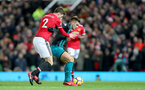 MANCHESTER, ENGLAND - DECEMBER 30: Southampton's Dusan Tadic(R) holds off Victor Lindelof of Manchester United during the Premier League match between Manchester United and Southampton at Old Trafford on December 30, 2017 in Manchester, England. (Photo by Matt Watson/Southampton FC via Getty Images)