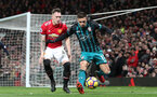 MANCHESTER, ENGLAND - DECEMBER 30: Southampton's Dusan Tadic(R) and Phil Jones of Manchester United during the Premier League match between Manchester United and Southampton at Old Trafford on December 30, 2017 in Manchester, England. (Photo by Matt Watson/Southampton FC via Getty Images)