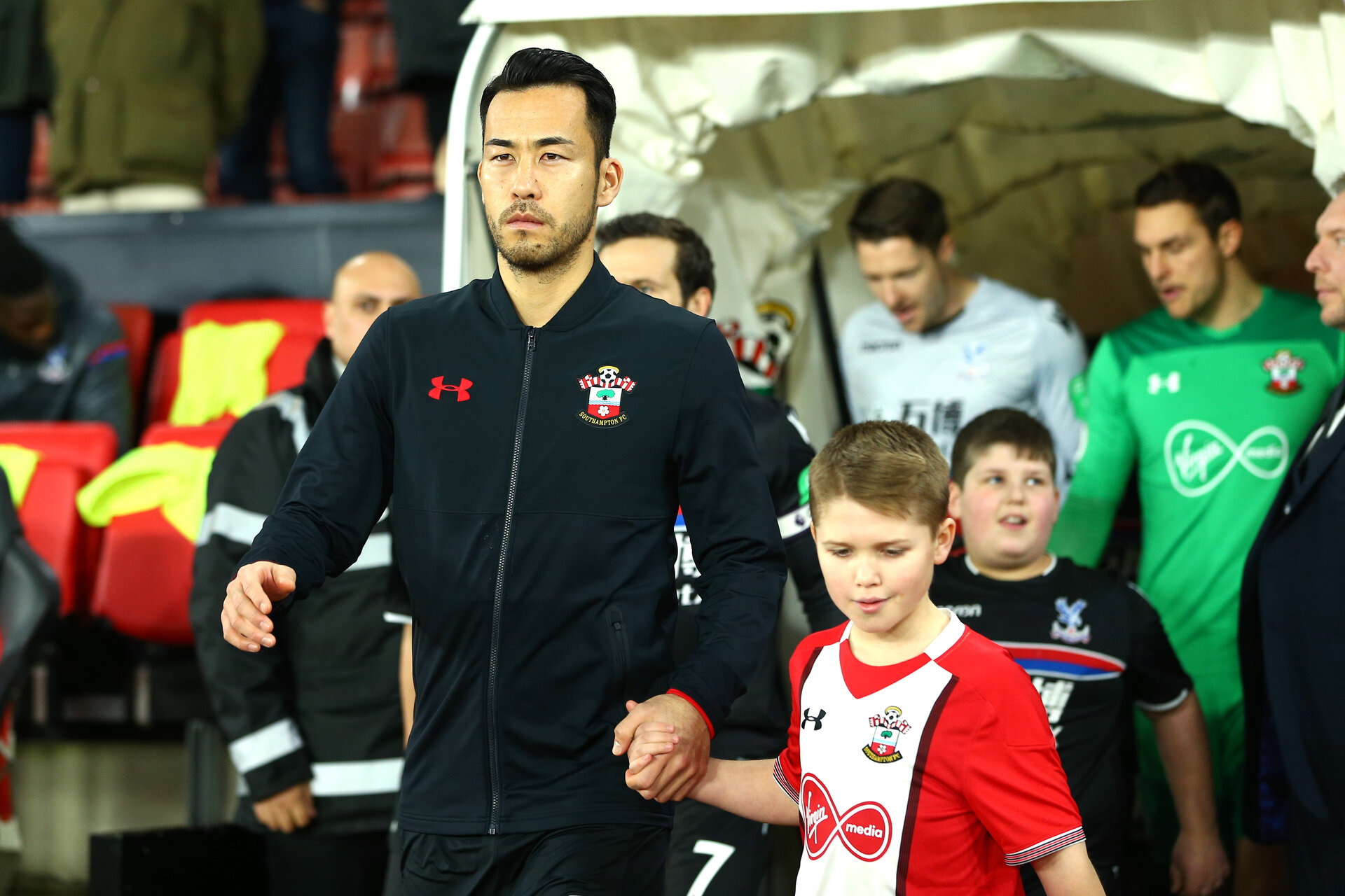 SOUTHAMPTON, ENGLAND - JANUARY 02: LtoR Maya Yoshida and Southampton FCÕs young mascot ahead of the Premier League match between Southampton and Crystal Palace at St Mary's Stadium on January 2, 2018 in Southampton, England. (Photo by James Bridle - Southampton FC/Southampton FC via Getty Images) SOUTHAMPTON, ENGLAND - JANUARY 02: LtoR Maya Yoshida and Southampton FC's young mascot ahead of the Premier League match between Southampton and Crystal Palace at St Mary's Stadium on January 2, 2018 in Southampton, England. (Photo by James Bridle - Southampton FC/Southampton FC via Getty Images)