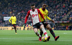 WATFORD, ENGLAND - JANUARY 13: Dusan Tadic(L) of Southampton under pressure from Molla Wague during the Premier League match between Watford and Southampton at Vicarage Road on January 13, 2018 in Watford, England. (Photo by Matt Watson/Southampton FC via Getty Images)