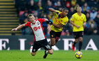 WATFORD, ENGLAND - JANUARY 13: James Ward-Prowse(L) of Southampton and Marvin Zeegelaar during the Premier League match between Watford and Southampton at Vicarage Road on January 13, 2018 in Watford, England. (Photo by Matt Watson/Southampton FC via Getty Images)