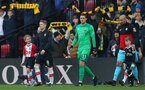 WATFORD, ENGLAND - JANUARY 13: Steven Davis(L) and Alex McCarthy of Southampton leads the team out with the match day mascot during the Premier League match between Watford and Southampton at Vicarage Road on January 13, 2018 in Watford, England. (Photo by Matt Watson/Southampton FC via Getty Images)