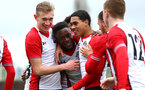 SOUTHAMPTON, ENGLAND - JANUARY 27: Jonathan Afolabi (middle) scores during the match between Southampton FC and Leicester FC U18s at Leicester FC Training ground on January 27, 2018 in Southampton, England. (Photo by James Bridle / Southampton FC via Getty Images)