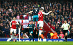 LONDON, ENGLAND - APRIL 08: Shane Long (left) of Southampton FC takes on Arsenal's Shkadran Mustafi (right) during the Premier League match between Arsenal and Southampton at Emirates Stadium on April 8, 2018 in London, England. (Photo by James Bridle - Southampton FC/Southampton FC via Getty Images)