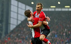WEST BROMWICH, ENGLAND - FEBRUARY 03: James Ward-Prowse(R) and Jack Stephens of Southampton FC celebrate during the Premier League match between West Bromwich Albion and Southampton at The Hawthorns on February 3, 2018 in West Bromwich, England. (Photo by Matt Watson/Getty Images)