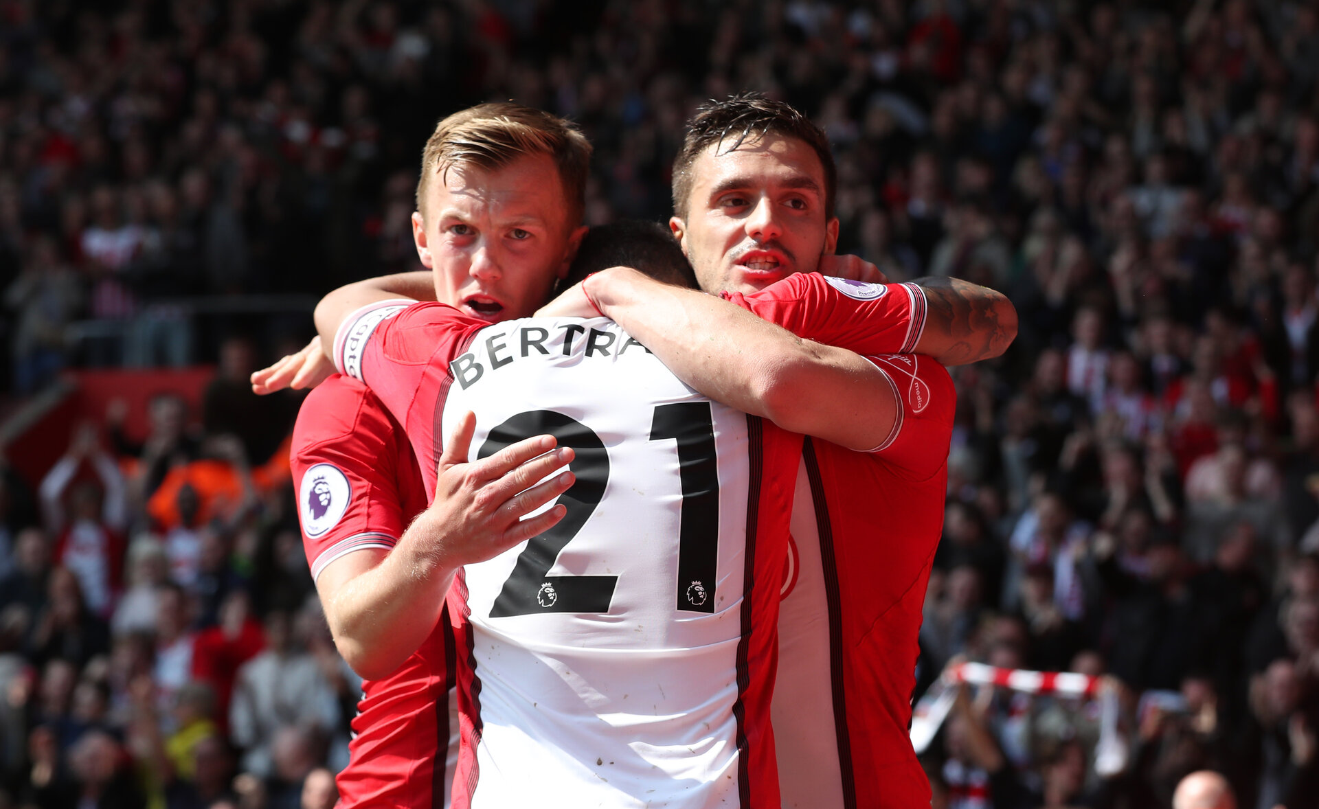 SOUTHAMPTON, ENGLAND - APRIL 14: Dusan Tadic(R), James Ward-Prowse(L) and Ryan Bertrand of Southampton celebrate after opening the scoring during the Premier League match between Southampton and Chelsea at St Mary's Stadium on April 14, 2018 in Southampton, England. (Photo by Matt Watson/Southampton FC via Getty Images)