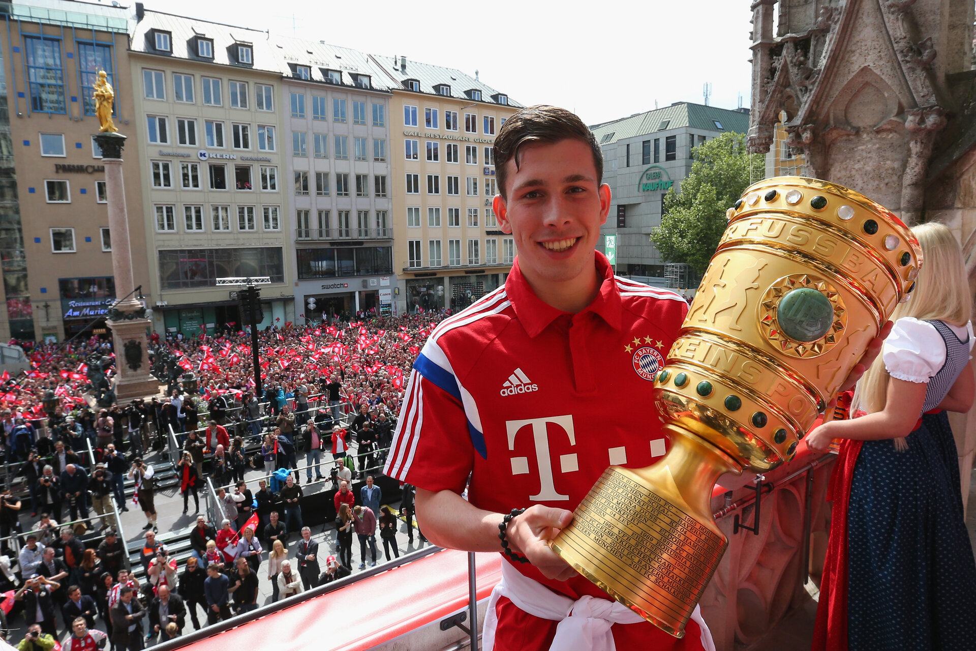MUNICH, GERMANY - MAY 18:  Pierre-Emile Hojbjerg of Bayern Muenchen holds the German cup winners trophy as the team celebrate winning the German Championship title and the German Cup finale on the town hall balcony at Marienplatz on May 18, 2014 in Munich, Germany.  (Photo by Alexander Hassenstein/Bongarts/Getty Images)
