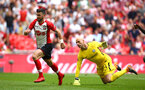 LONDON, ENGLAND - APRIL 22: Shane Long (left) of Southampton gets round Chelsea FC Goal Keeper Willy Caballero (right) during the Semi Final of the Emirates FA Cup between Southampton FC and Chelsea FC at Wembley Stadium on April 22, 2018 in London, England. (Photo by James Bridle - Southampton FC/Southampton FC via Getty Images)