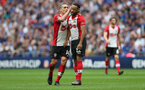 LONDON, ENGLAND - APRIL 22: Nathan Redmond(R) and Oriol Romeu(L) of Southampton during the Emirates FA Cup Semi-Final between Chelsea and Southampton, at Wembley Stadium on April 22, 2018 in London, England. (Photo by Matt Watson/Southampton FC via Getty Images)