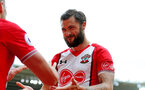 SOUTHAMPTON, ENGLAND - APRIL 28: Charlie Austin of Southampton celebrates after Dusan Tadic scores for Southampton during the Premier League match between Southampton and AFC Bournemouth at St Mary's Stadium on April 28, 2018 in Southampton, England. (Photo by Matt Watson/Southampton FC via Getty Images)