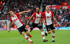SOUTHAMPTON, ENGLAND - APRIL 28: Dusan Tadic(L) of Southampton celebrates after scoring his second to make it 2-1 to Southampton with team mates Nathan Redmond(centre) and Oriol Romeu(R) during the Premier League match between Southampton and AFC Bournemouth at St Mary's Stadium on April 28, 2018 in Southampton, England. (Photo by Matt Watson/Southampton FC via Getty Images)