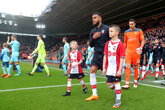 Walk out with Saints against Manchester City