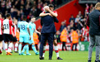 SOUTHAMPTON, ENGLAND - APRIL 28: Wesley Hoedt hugs Mark Hughes after the final whistle is blown for the Premier League match between Southampton and AFC Bournemouth at St Mary's Stadium on April 28, 2018 in Southampton, England. (Photo by James Bridle - Southampton FC/Southampton FC via Getty Images)