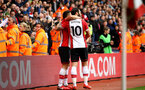 SOUTHAMPTON, ENGLAND - APRIL 28: LtoR Dusan Tadic, Charlie Austin of Southampton FC during the Premier League match between Southampton and AFC Bournemouth at St Mary's Stadium on April 28, 2018 in Southampton, England. (Photo by James Bridle - Southampton FC/Southampton FC via Getty Images)