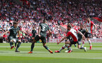 SOUTHAMPTON, ENGLAND - MAY 13: Jack Stephens of Southampton shoots at goal during the Premier League match between Southampton and Manchester City at St Mary's Stadium on May 13, 2018 in Southampton, England. (Photo by Matt Watson/Southampton FC via Getty Images)