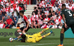 SOUTHAMPTON, ENGLAND - MAY 13: Dusan Tadic rounds Claudio Bravo during the Premier League match between Southampton and Manchester City at St Mary's Stadium on May 13, 2018 in Southampton, England. (Photo by Chris Moorhouse/Southampton FC via Getty Images)