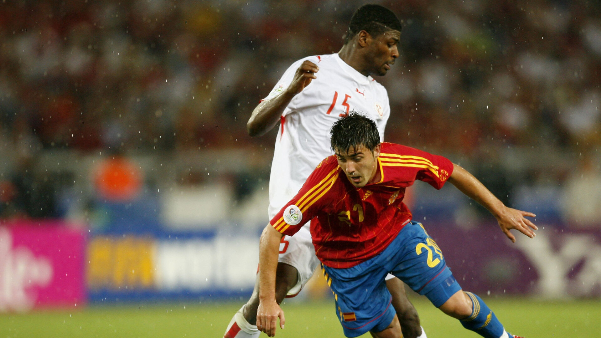 STUTTGART, GERMANY - JUNE 19:  David Villa of Spain is brought down by Radhi Jaidi of Tunisia during the FIFA World Cup Germany 2006 Group H match between Spain and Tunisia at the Gottlieb-Daimler Stadium on June 19, 2006 in Stuttgart, Germany.   (Photo by Michael Steele/Getty Images)