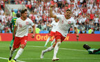 MOSCOW, RUSSIA - JUNE 19:  Grzegorz Krychowiak of Poland celebrates with teammate Jan Bednarek after scoring his team's first goal during the 2018 FIFA World Cup Russia group H match between Poland and Senegal at Spartak Stadium on June 19, 2018 in Moscow, Russia.  (Photo by Shaun Botterill/Getty Images)