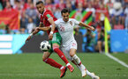 MOSCOW, RUSSIA - JUNE 20:  Hakim Ziyach of Morocco battles for possession with Cedric of Portugal during the 2018 FIFA World Cup Russia group B match between Portugal and Morocco at Luzhniki Stadium on June 20, 2018 in Moscow, Russia.  (Photo by Stu Forster/Getty Images)