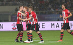 KUNSHAN, CHINA - JULY 05: Harrison Reed is congratulated by his team mates after scoring during the pre season 2018 Clubs Super Cup match between Southampton FC and FC Schalke, at Kunshan Sports Center on July 5, 2018 in Kunshan, China. (Photo by Matt Watson/Southampton FC via Getty Images)