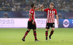 KUNSHAN, CHINA - JULY 05: Nathan Redmond(L) is congratulated by Stewart Armstrong, bot of Southampton during the pre season 2018 Clubs Super Cup match between Southampton FC and FC Schalke, at Kunshan Sports Center on July 5, 2018 in Kunshan, China. (Photo by Matt Watson/Southampton FC via Getty Images)