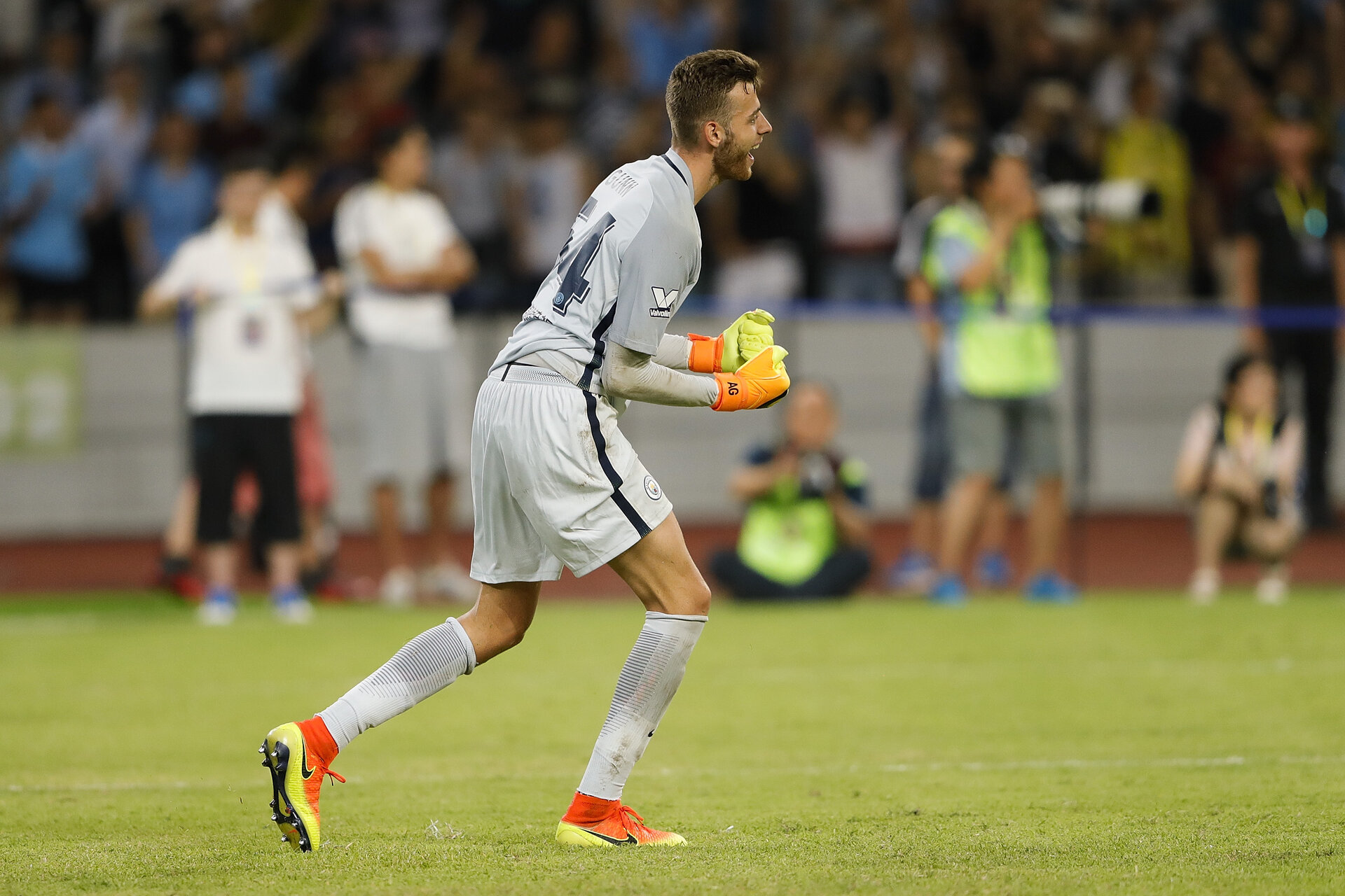 SHENZHEN, CHINA - JULY 28:  Angus Gunn of Manchester City reacts  during the 2016 International Champions Cup match between Manchester City and Borussia Dortmund at Shenzhen Universiade Stadium on July 28, 2016 in Shenzhen, China.  (Photo by Lintao Zhang/Getty Images)