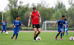 SHANGHAI, CHINA - JULY 09: A local youth team joins in with Southampton players during a Southampton FC training session, Pierre-Emile Hojbjerg, while on their pre season tour of China, on July 9, 2018 in Xuzhou, China. (Photo by Matt Watson/Southampton FC via Getty Images)