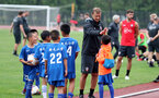 SHANGHAI, CHINA - JULY 09: A local youth team joins in with Southampton players and staff during a Southampton FC training session, while on their pre season tour of China, on July 9, 2018 in Xuzhou, China. (Photo by Matt Watson/Southampton FC via Getty Images)