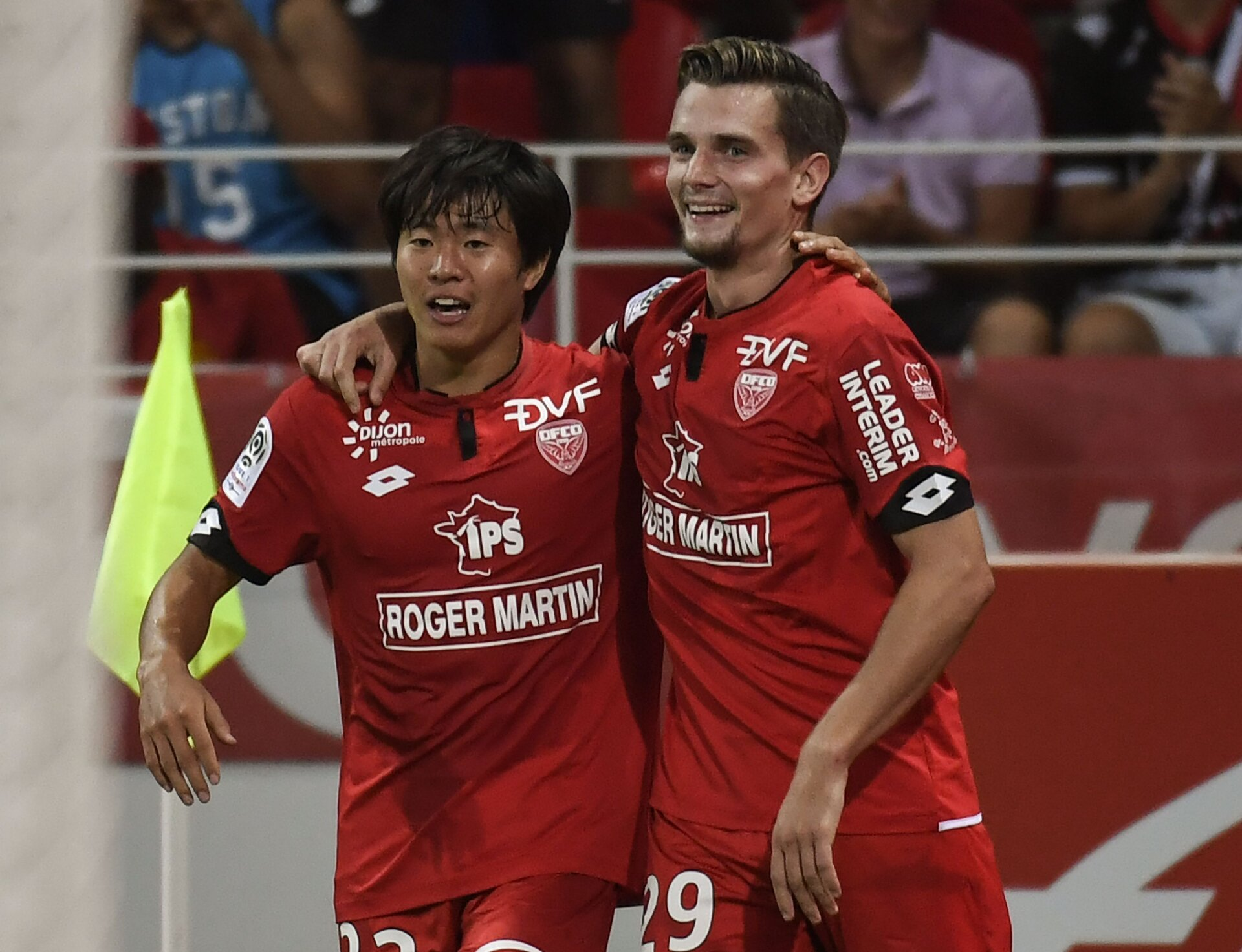Dijon's French forward Benjamin Jeannot celebrates with his teammate Dijon's South-Korean midfielder Chang Hoon Kwon (L) after scoring a goal during the L1 football match Dijon FCO against Montpellier HSC at The Gaston Gerard Stadium in Dijon, eastern France on August 26, 2017. / AFP PHOTO / PHILIPPE DESMAZES        (Photo credit should read PHILIPPE DESMAZES/AFP/Getty Images)