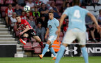 SOUTHAMPTON, ENGLAND - AUGUST 01: Matt Targett of Southampton FC crosses to assist Charlie Austin during the pre-season friendly match between Southampton and Celta Vigo at St Mary's Stadium on August 1, 2018 in Southampton, England. (Photo by Matt Watson/Southampton FC via Getty Images)