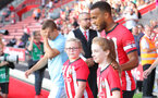 SOUTHAMPTON, ENGLAND - AUGUST 01: Ryan Bertrand of Southampton FC leads the teams out with the matchday mascots during the pre-season friendly match between Southampton and Celta Vigo at St Mary's Stadium on August 1, 2018 in Southampton, England. (Photo by Matt Watson/Southampton FC via Getty Images)