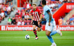 SOUTHAMPTON, ENGLAND - AUGUST 01: Stuart Armstrong (left) during the Pre-Season friendly match between Southampton FC and Celta Vigo pictured at St Mary's Stadium on August 1, 2018 in Southampton, England. (Photo by James Bridle - Southampton FC/Southampton FC via Getty Images)