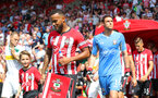SOUTHAMPTON, ENGLAND - AUGUST 04: Ryan Bertrand of Southampton FC leads teams out with the matchday mascot during the pre-season friendly match between Southampton and Borussia Monchengladbach at St Mary's Stadium on August 4, 2018 in Southampton, England. (Photo by Matt Watson/Southampton FC via Getty Images)