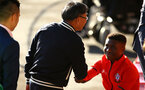 SOUTHAMPTON, ENGLAND - AUGUST 10:  Gao Jisheng greets Nathan Tella ahead of the PL2 match between Southampton FC vs Middlesbrough FC pictured at Staplewood Complex on August 10, 2018 in Southampton, England. (Photo by James Bridle - Southampton FC/Southampton FC via Getty Images)